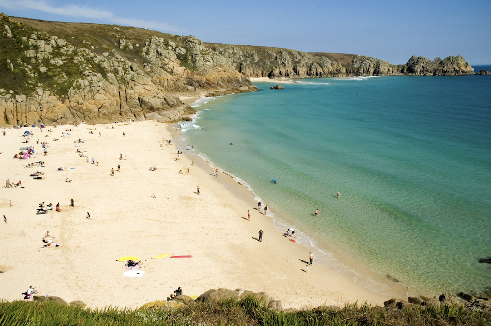 Surfing, swimming and walking at Porthcurno Beach in West Cornwall